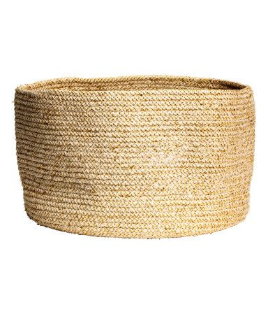 Beige/gold-colored. Storage basket in thick melange cotton fabric with glittery threads. Height 9 in., diameter approx. 13 3/4 in.