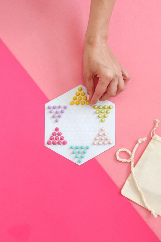 This travel Chinese checkers set is pocket size and magnetic, so you can play it anywhere. Let's go!