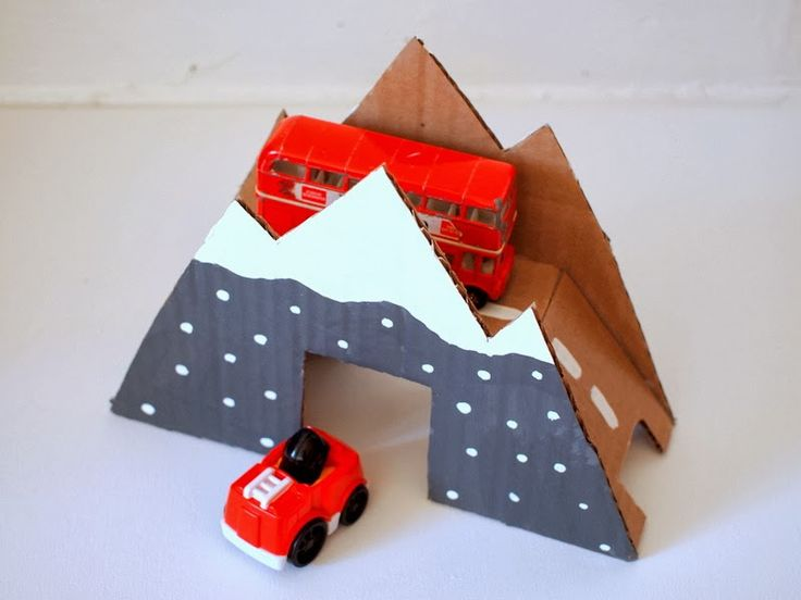 This cardboard mountain would make a great addition to a collection of DIY winter train set scenery -- a fun gift in itself, or a great way to present a brand new train set or train table.