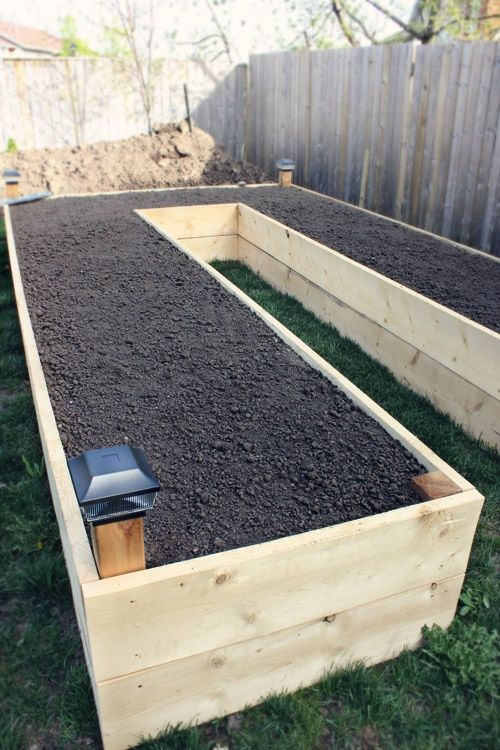 Building a Raised Garden Bed. Like this idea to save my poor back!