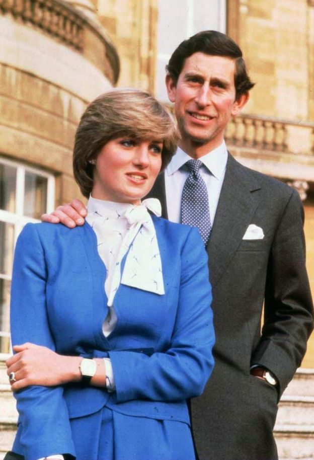 Princess Diana with Prince Charles standing several steps higher in order to appear taller than her