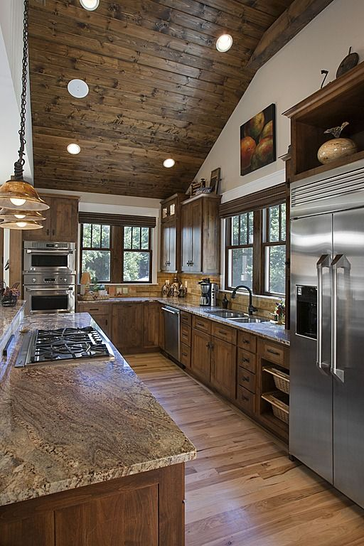 love the ceiling - slope/lights/wood Craftsman kitchen