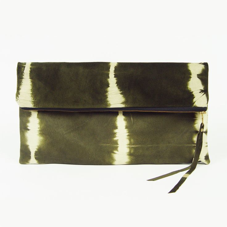 Oversized clutch bag, handmade from tie dyed cowhide. (http://www.ifoundlove.com.au/oversized-tie-dyed-leather-clutch/)