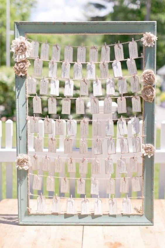 Rustic frame seating chart decor / http://www.himisspuff.com/creative-seating-cards-and-displays/8/