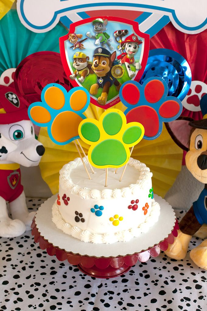 Make a super easy and super quick Paw Patrol party cake with the help of a grocery store cake and pre-printed and cut paper items.