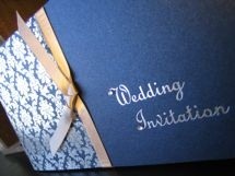 Vintage Cheque book wedding invitation by White Crafts