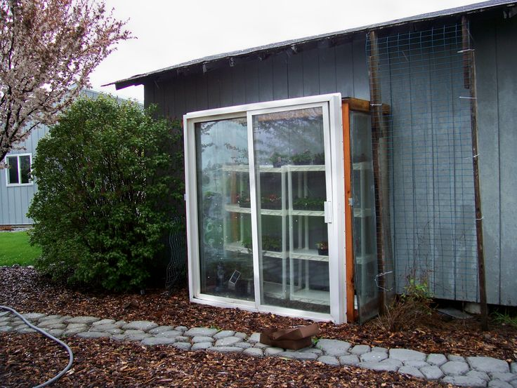 A simple upright cold frame we used the old slider from for Back door frame