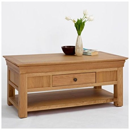 Oak One Drawer Coffee Table made of solid oak wood. This Oak Furniture Coffee Table has one drawer for storage and a shelf underneath. This Coffee Table has chunky Oak Legs with dark wooden knobs.