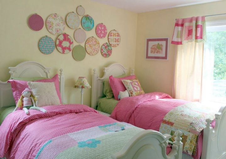 fabric on embroidery hoops - great way to quickly update PJ's room.  And goodness knows I have enough fabric!!!