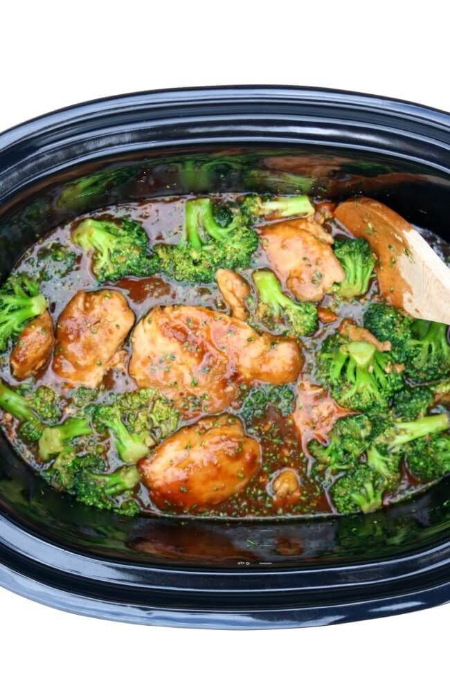 Slow Cooker Honey Garlic Chicken--an easy Asian crockpot recipe for tender chicken thighs in a lemon, soy sauce, honey and garlic sauce.