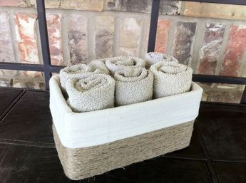 """Rescue a kleenex box from the garbage by covering it with jute and adding a cloth liner to make a storage """"basket"""" for extra washcloths."""