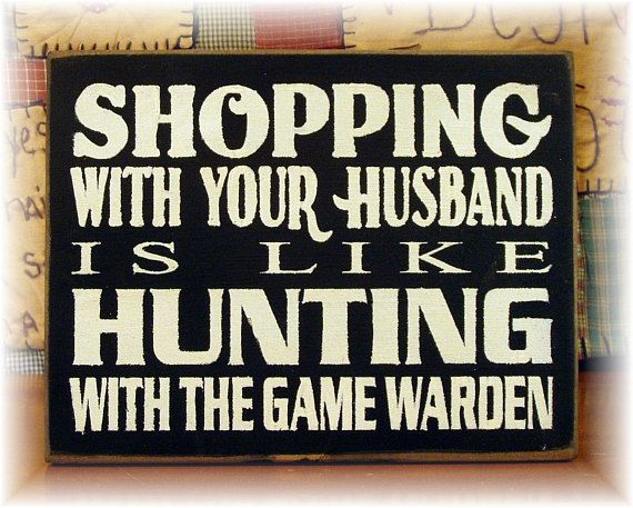 Pictured in black with cream lettering. If you would like another color combination please let me know. All of my signs are sprayed with a clear sealer and come ready to hang with a sawtooth hanger on the back. The sign reads Shopping with your husband is like hunting with the Game