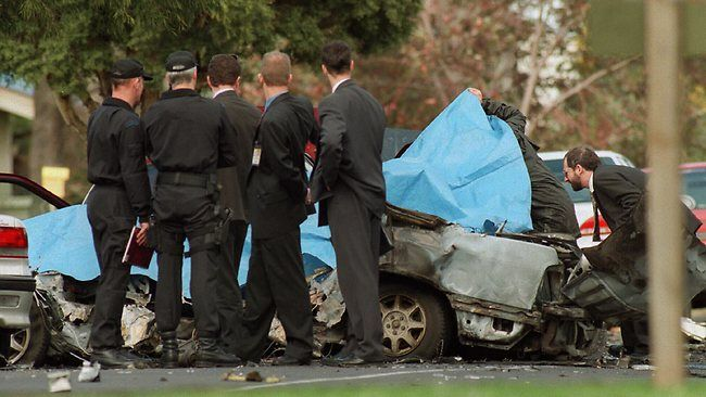 Police survey the wreckage of John Furlan's car.