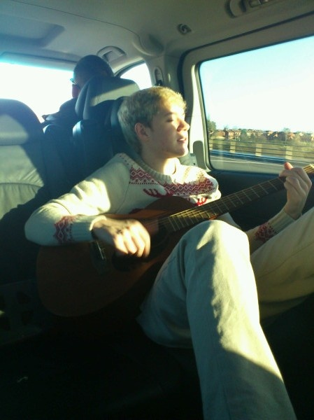playing his guitar in the car :)