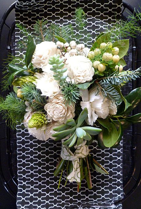 wedding bouquet of carnations, wood Sola flowers, Star of Bethlehem, Douglas fir,  succulents, tallow berries, hypericum berries, Camellia buds, holly greens, and asparagus fern