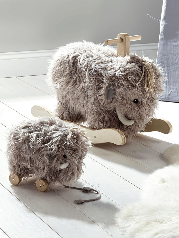 The perfect companions for any little one, our friendly pull toy and rocking mammoth are crafted from wood, with a super soft grey furry finish. Providing hours of fun, they will also make a beautiful decorative addition to a nursery or playroom.  Padded for extra cuddliness, their sweet faces are framed with a shaggy fringe.