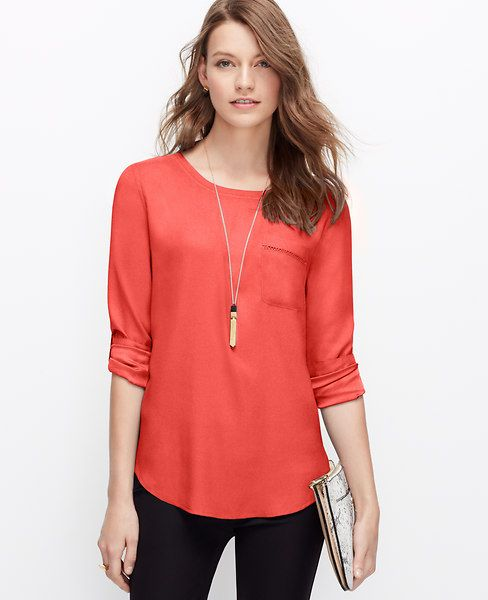 Ann Taylor The forecast for spring looks bright and breezy with warm hues, simple silhouettes and playful prints. Round neck. Long sleeves with button tabs. Front patch pocket with scroll stitched trim. Button cuffs. Back yoke with box pleat. Shirttail hem.