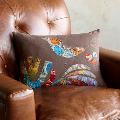 I would love to use some cool fabric finds to make a pillow like this.