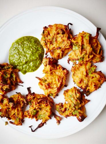 Meera Modha's baked onion bhajis (pyaz ke pakore) are a step forward from the deep-fried favourites: they are healthier, more pleasant to cook, and just as tasty. Serve with a fresh coriander or mango chutney, or beetroot raita. Yum!
