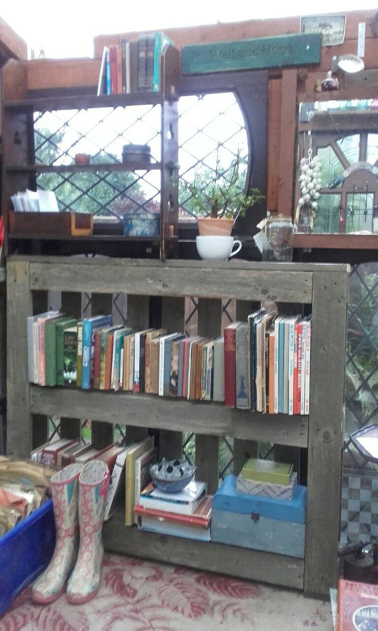 The conservatory gets a pallet bookshelf