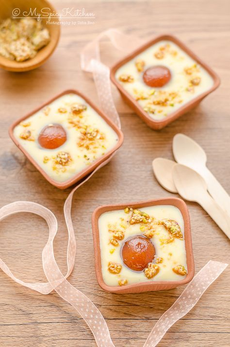 Gulab jamun custard is a fusion Indian dessert with plain custard is served with gulab jamun and topped with praline or nuts brittle.
