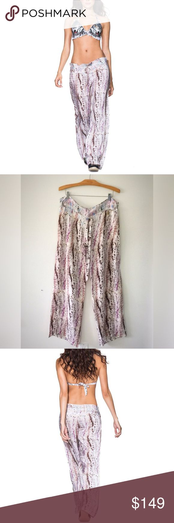NWT AGUA BENDITA Absolutely gorgeous and impossible to find😉 BENDITO WOLF pants by Colombian luxe swim house AGUA BENDITA 2015 Collection... Drawstring waist and 💯 Silk.. these pants are a summer must have!! Never worn... tags attached... PRICE FIRM unless bundled Agua Bendita Pants