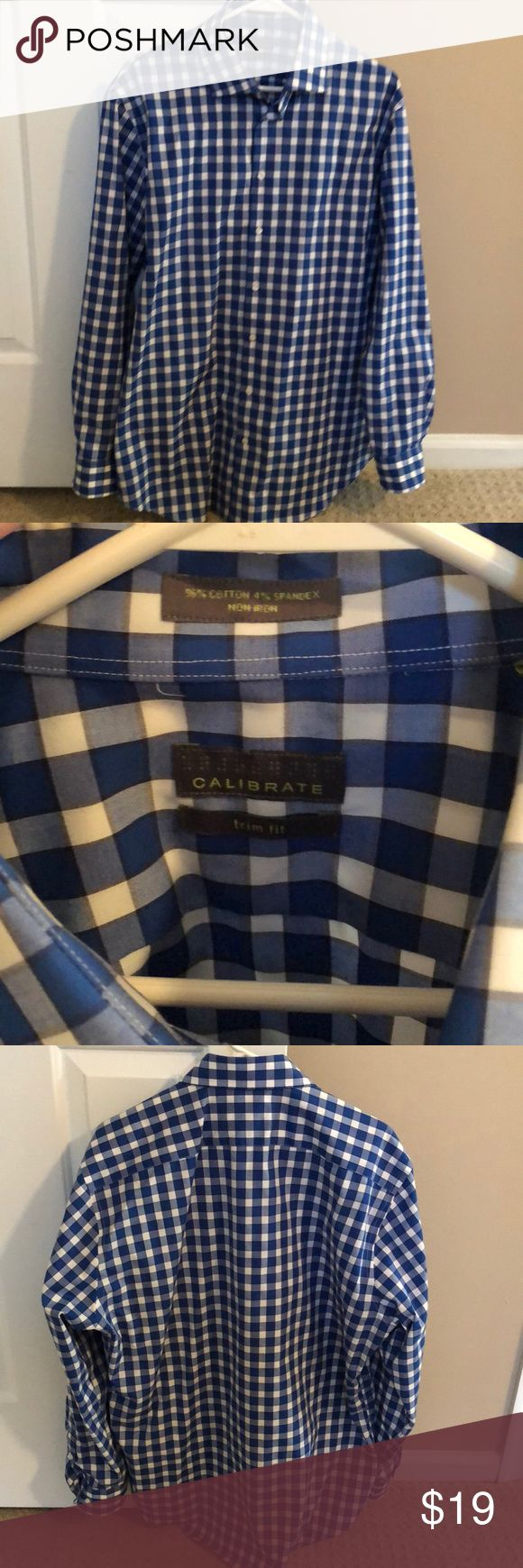 Calibrate Blue Men's Dress Shirt Non Iron Trim Fit Calibrate Men's plaid Blue Dress Shirt, size Large, Non Iron, Trim Fit, 96% cotton, 4% spandex.  Great condition, worn twice.  Any questions, just ask.  Bundle with other items of mine from my closet and save more! Calibrate Shirts Dress Shirts
