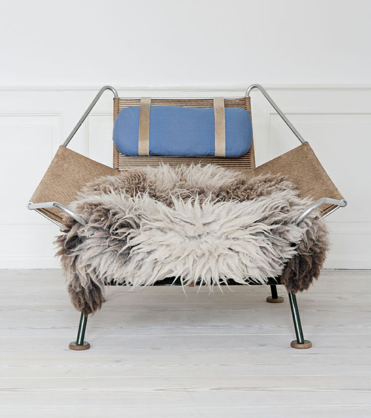 Hans Wegner, Denmark    The original `Flagline` lounge chair with sheepskin throw.
