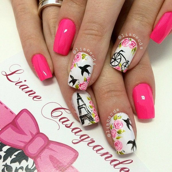 A very candid yet fun looking pink nail art design. Apart from the matte pink polish, white matte color is also used. Additional details such as the Eiffel, doves and a bike in black polish are there as well as pink roses.