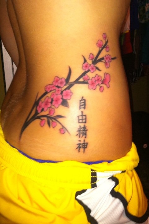 Free Spirit in Japanese, and Cherry Blossoms represent living each day to the fullest and feminine beauty.