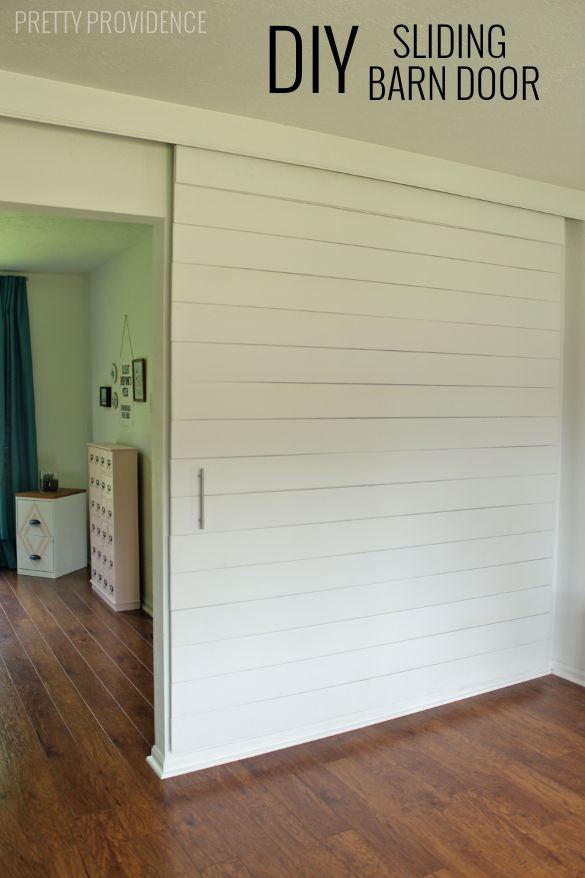 DIY Sliding Barn Door - an awesome modern addition to your home & this is a really affordable way to do it.