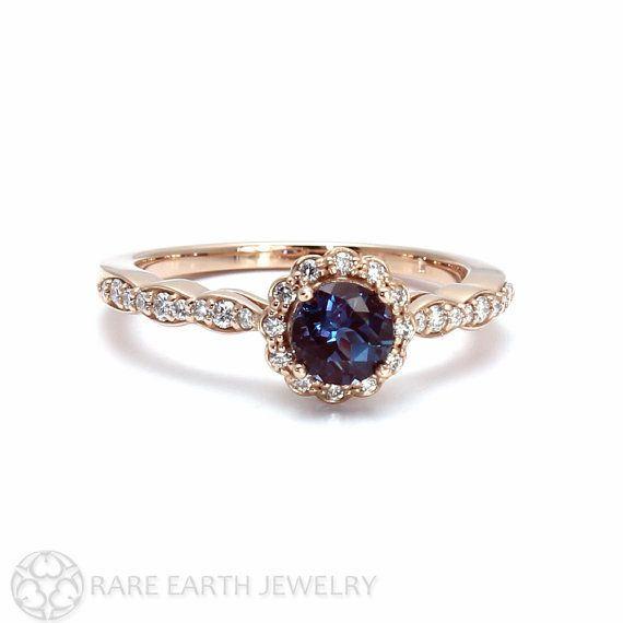 A beautiful color change Alexandrite ring with a pretty diamond halo and shank. Alexandrite is a truly amazing stone, changing from a dramatic dark