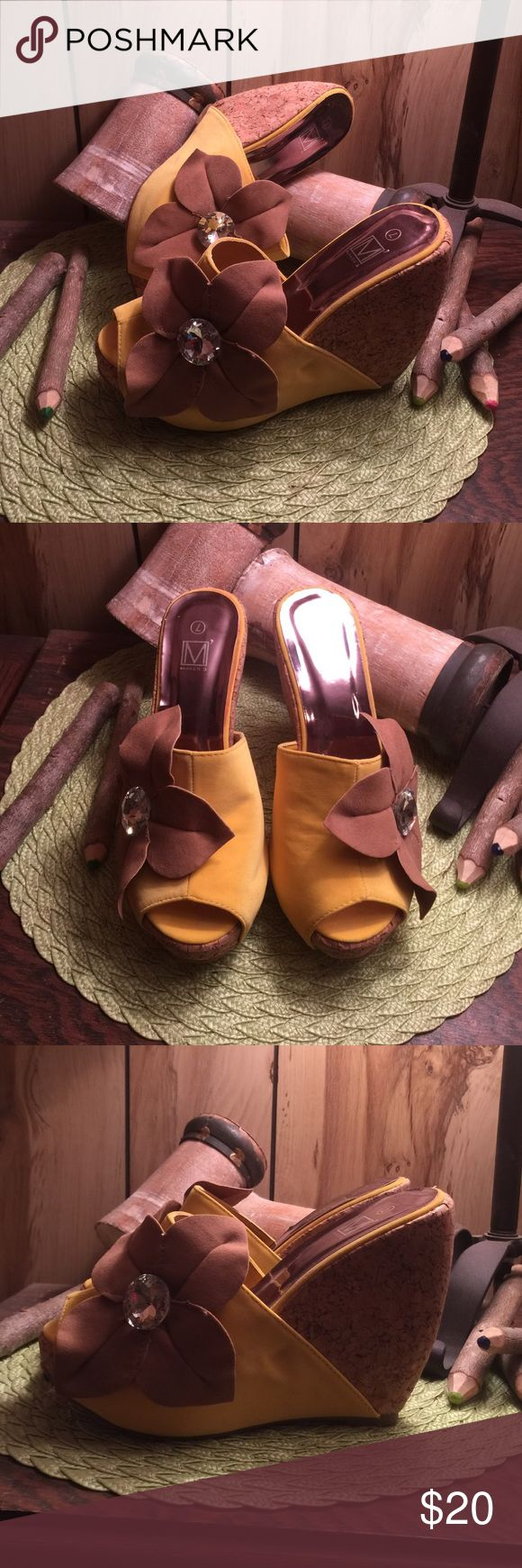 Fabulous yellow wedges! These are so unique you will want to wear them all the time! Great with skinnys and skirts! Mint condition and worn very little! Adorned with large brown petals with bling center! 4inches if fabulous! makers Shoes Wedges