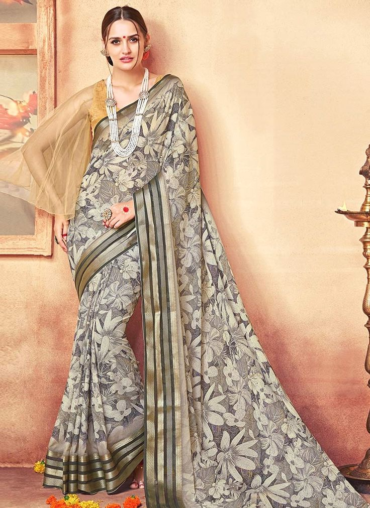 Buy sarees online from among a variety of latest designer sarees. Grab this faux georgette grey printed saree.