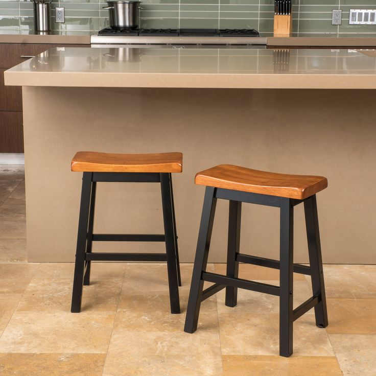 The Toluca saddle wood counter stool is the perfect piece to add to your serving area, this counter stool is comfortably designed and easily fits your indoor needs. Enjoy this counter stool with your