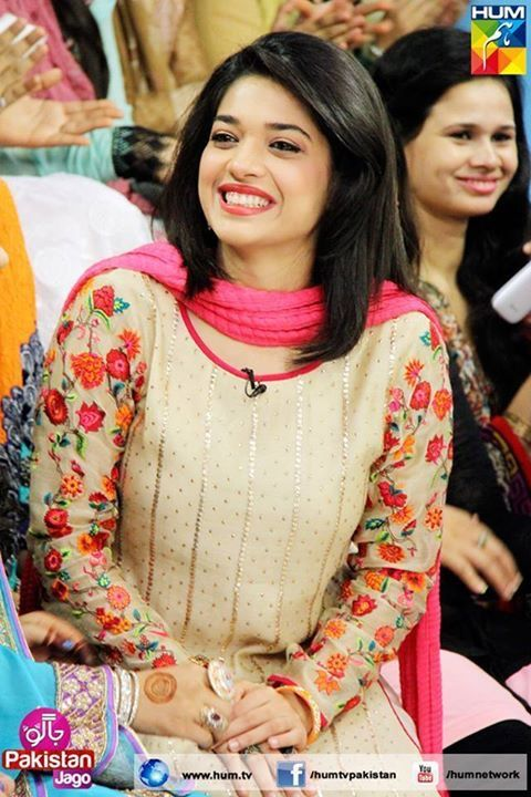 Love her smile and dress is fab