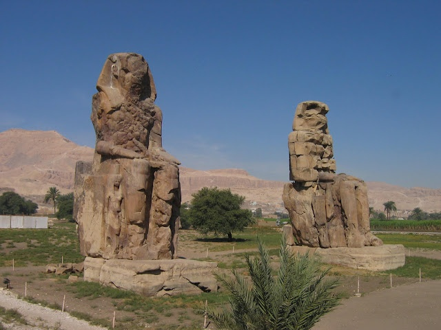 The Colossi of Memnon, Egypt, guarding entrance pylon to mortuary temple of Amenophis III,