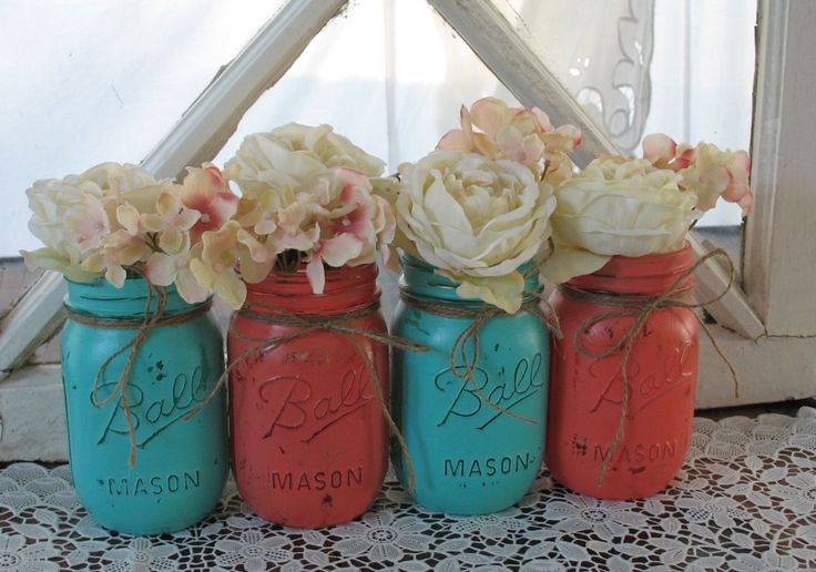 This is a SET OF 4 hand painted mason jars. Two of each color: Dark Coral And Turquoise (Flowers and accessories are for inspiration only and are not included in the set).