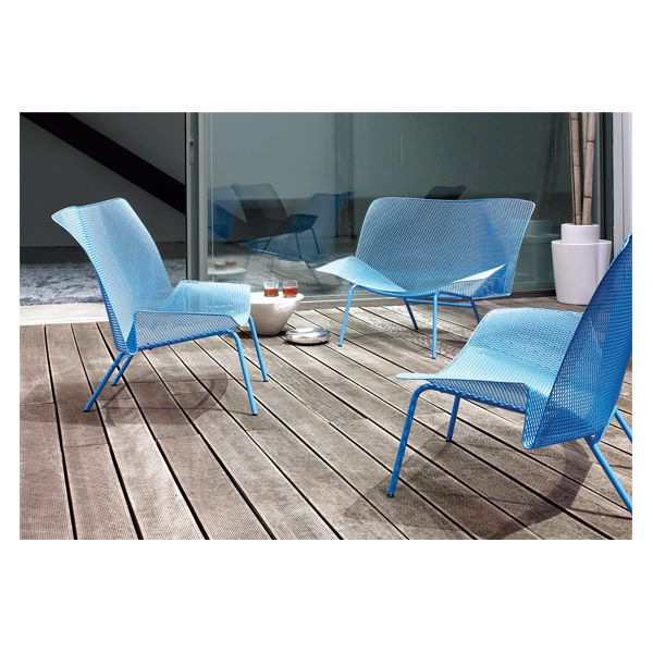 Grillage by François Azambourg for Ligne Roset  Fashioned from a single sheet of perforated metal, treated against corrosion and with a two layers of anti-rust and anti-UV lacquers, the Grillage range by Françoise Azambourg ups your seating sizzle.  www.ligne-roset-usa.com
