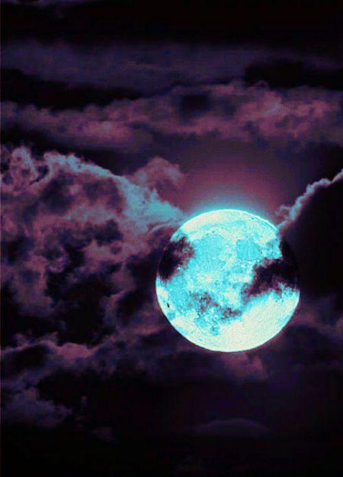 Cyan moon in purple clouds.