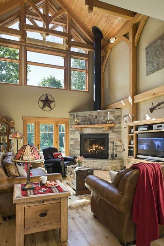 The simplicity of this corner fireplace, paired with the soaring ceiling and multiple windows, brings a feeling of openness to this great ro...