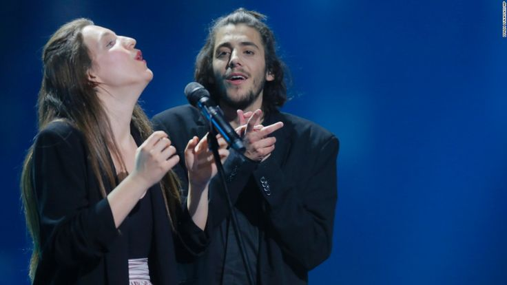 """Portugal's Salvador Sobral wins the Eurovision Song Contest, the wildly popular annual competition that pits singers from nations in the European Broadcasting Union. The winning song, """"Amar Pelos Dois"""" (""""For The Both Of Us"""") was written by Sobral's sister, Luisa. CNN 0 May 13, 2017"""