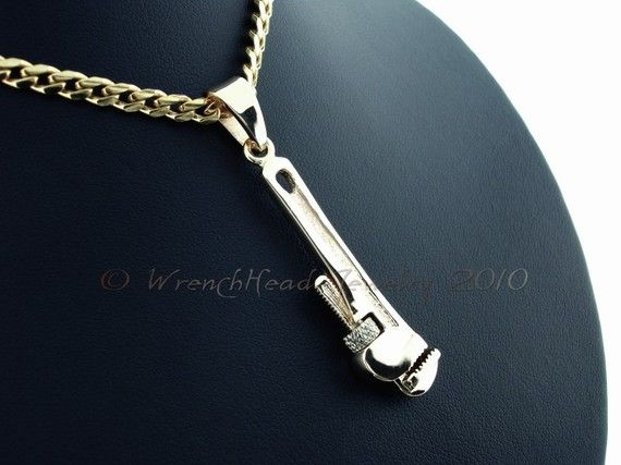 Hey, I found this really awesome Etsy listing at https://www.etsy.com/listing/68981214/14kt-gold-pipe-wrench-pendant