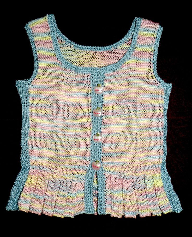 A knitted top for a baby girl