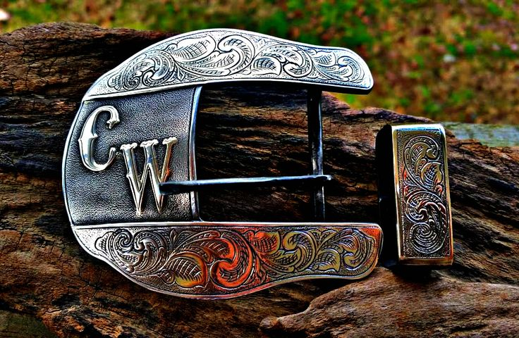 Sterling overlay on Shape 2 belt buckle. Hand fabricated and engraved. Custom belt buckles with your ranch brand, initials, logo, etc available from BluegrassEngraving.com.