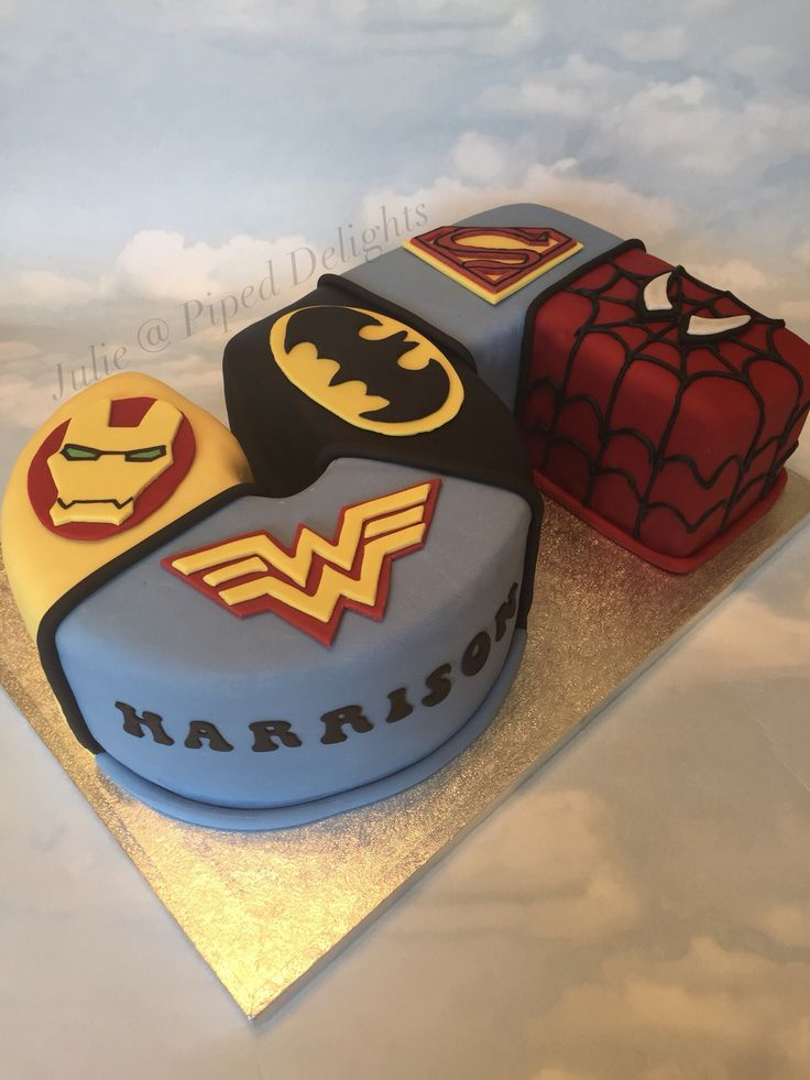 Age 5 Superhero Cake by Julie @ Piped Delights. For a little superhero fan with Spiderman, Superman, Batman, Wonder Woman & Iron Man faces/logos.