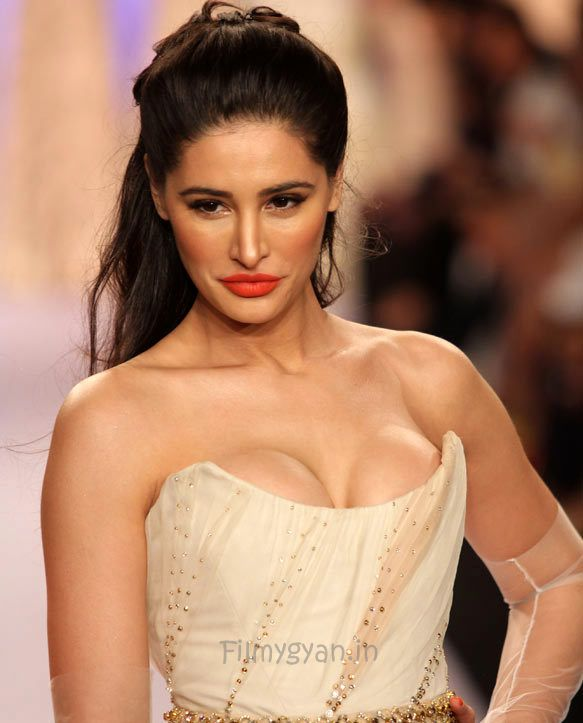 Nargis Fakhri scorched the ramp in the creation by Shehla Khan. The actress was seen in an ivory corset gown. The outfit with its net sleeves and cuff embellished with sequins had an cosmic appeal....