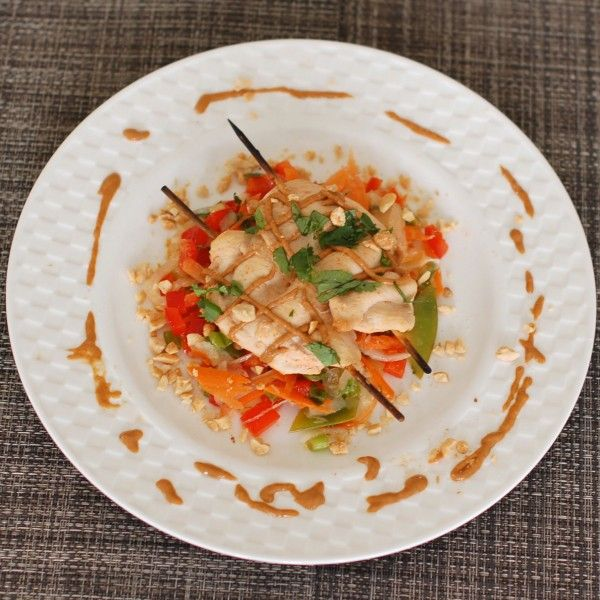 Thai Peanut Chicken Satay recipe: Marry the heat of sriracha with the coolness of coconut milk and cilantro. #appetizer #entree #crowdpleaser