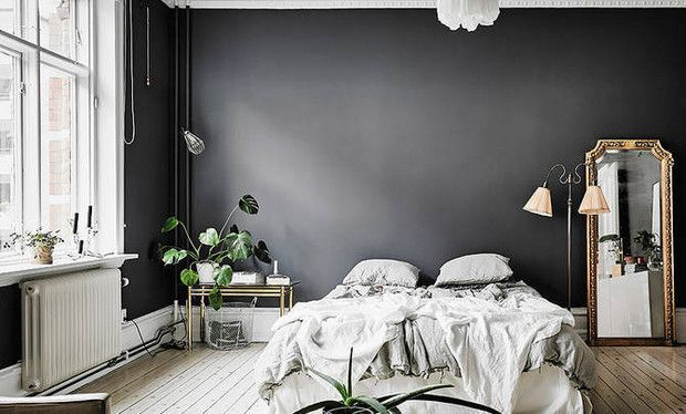 Consider this Scandinavian master bedroom an ideal case study for perfecting modern elegance. We're swooning over the coupling of the casual bedding situation and the ornate mirror set directly aside. black white gold