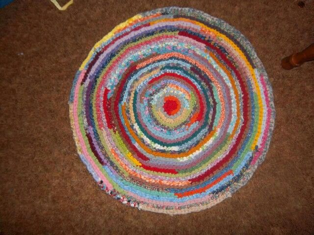 Crocheted rag rug.. made with cotton sheets. Created by Amy Marie Hann